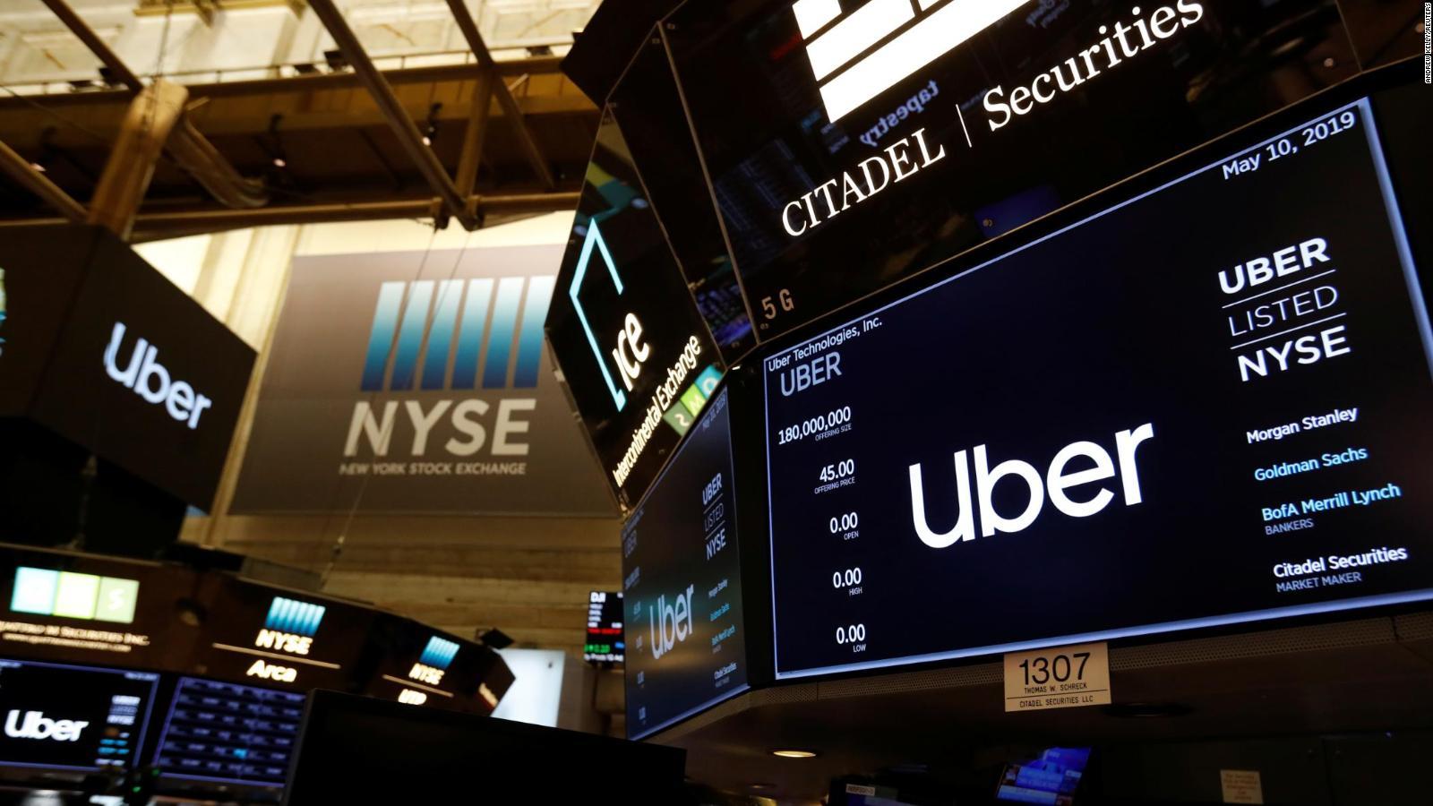 Uber opens below IPO price in market debut