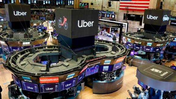 Uber logos top trading posts on the floor of the New York Stock Exchange, Friday, May 10, 2019. The world