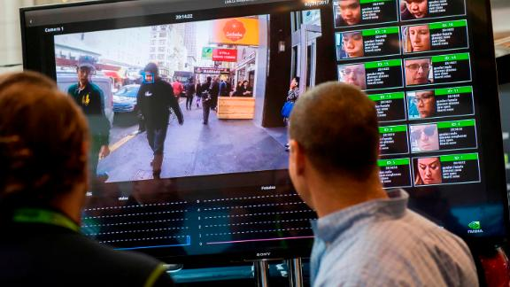 A display showing a facial recognition system for law enforcement during the NVIDIA GPU Technology Conference.