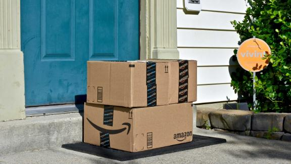 MARYLAND, USA - JUNE 17, 2016: Amazon Prime boxes delivered to the front door of a home. Amazon is the largest Internet-based retailer in the United States. - Image