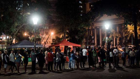 Voters rush to cast their votes hours before polling stations close at the Durban City Hall at the sixth national general elections in Durban on May 8.