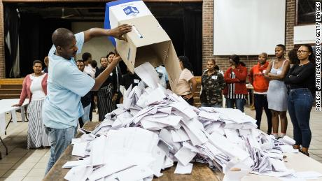 An Independent Electoral Officer (IEC) opens a ballot box as counting begins at the Addington Primary School after voting ended at the sixth national general elections in Durban on Wednesday.