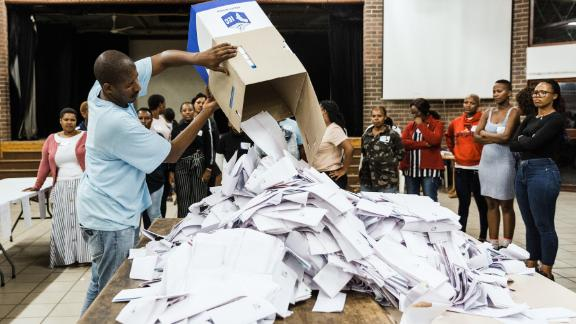 TOPSHOT - An Independent Electoral Officer (IEC) opens a ballot box as counting begins at the Addington Primary School after voting ended at the sixth national general elections in Durban, on May 8, 2019. (Photo by RAJESH JANTILAL / AFP)        (Photo credit should read RAJESH JANTILAL/AFP/Getty Images)