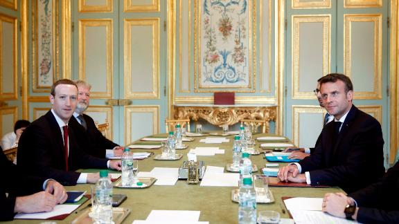 Facebook CEO Mark Zuckerberg, left, and French President Emmanuel Macron met to discuss  how to regulate social media.