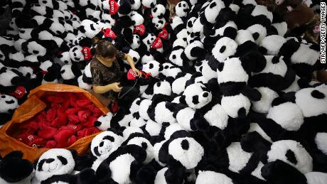 This photo taken on October 9, 2017 shows a Chinese employee making stuffed panda toys as they are prepared to export for the upcoming Christmas festive season, at a toy factory in Lianyungang in China's eastern Jiangsu province. / AFP PHOTO / STR / China OUT        (Photo credit should read STR/AFP/Getty Images)