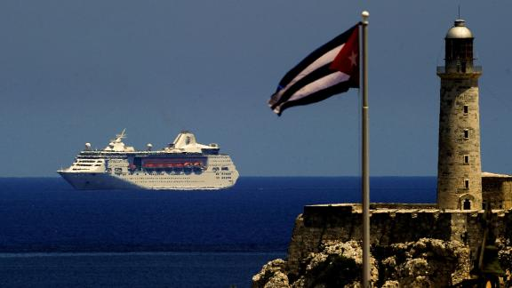 TOPSHOT - A Royal Caribbean cruise sails into the Havana harbour, on May 6, 2019. - The activation of Chapter III of the Helms-Burton Act that seeks to intensify the US blockade against Cuba will particularly affect the self-employed sector by limiting the trips of Americans to the island. In April, US President Donald Trump ramped up pressure on Cuba with new restrictions on US travel and remittances and a green light to lawsuits over seized property as he vowed to rid Latin America of leftists. (Photo by Yamil LAGE / AFP)        (Photo credit should read YAMIL LAGE/AFP/Getty Images)