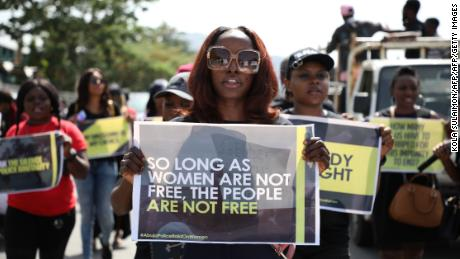Women march during a protest to challenge impunity and gender-based discrimination raids on women by Federal Capital Territory and Nigerian Police, in Abuja on May 10, 2019. (Photo by Kola SULAIMON / AFP)        (Photo credit should read KOLA SULAIMON/AFP/Getty Images)