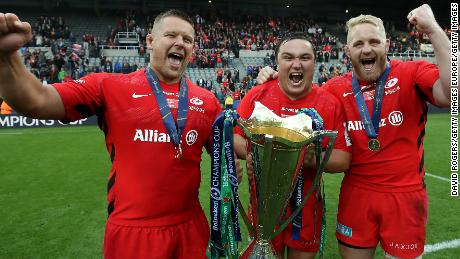 NEWCASTLE UPON TYNE, ENGLAND - MAY 11:   (L-R) Richard Barrington, Jamie George and Vincent Koch of Saracens celebrate their victory during the Champions Cup Final match between Saracens and Leinster at St. James Park on May 11, 2019 in Newcastle upon Tyne, United Kingdom. (Photo by David Rogers/Getty Images)
