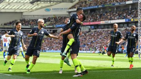 Man City players celebrate taking the lead againt Brighton