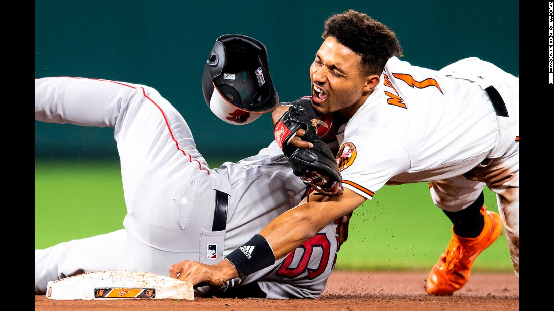 Richie Martin of the Baltimore Orioles collides with Eduardo Nunez of the Boston Red Sox as he steals second base during the eighth inning of a game on May 8, 2019, at Oriole Park at Camden Yards in Baltimore.