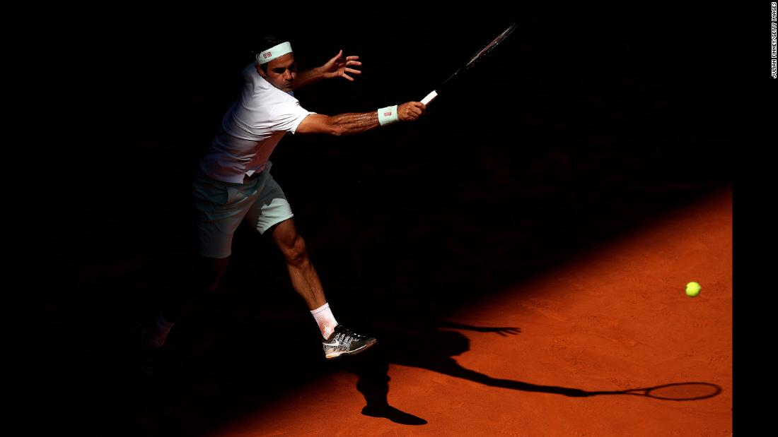 Roger Federer of Switzerland plays a forehand against Gael Monfils of France during Day Six of the Mutua Madrid Open at La Caja Magica on May 9 in Madrid.