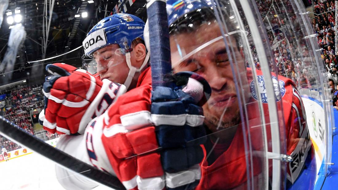 Jakub Vrana of the Czech Republic (left) checks Mattias Norstebo of Norway (right) during the IIHF World Championship group B ice hockey match between Norway and Czech Republic on May 11 at the Ondrej Nepela Arena in Bratislava, Slovakia.