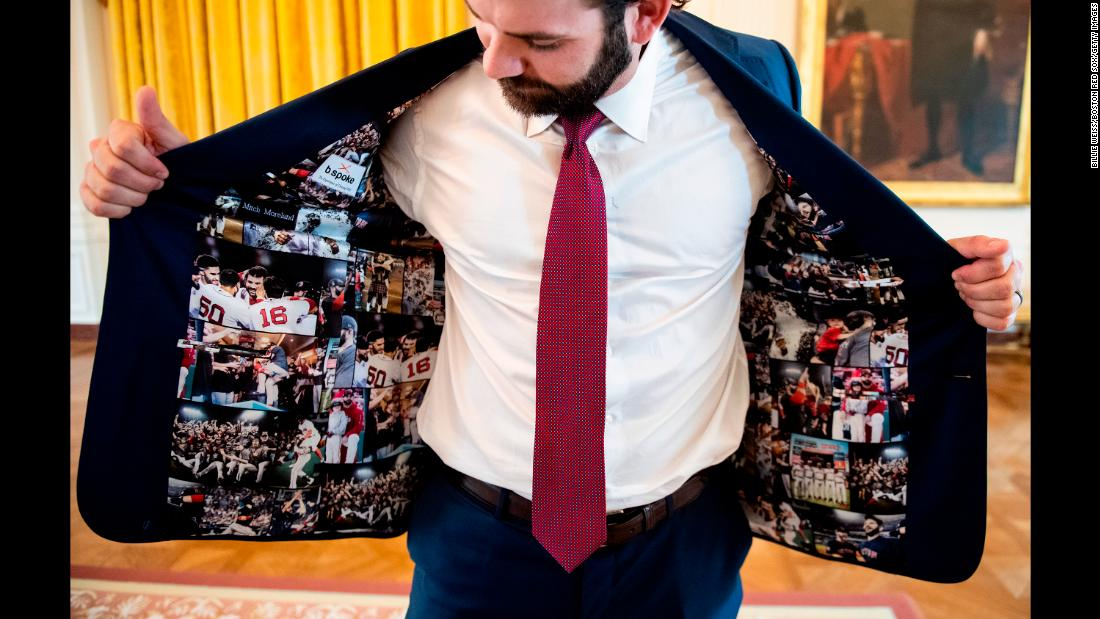 Mitch Moreland of the Boston Red Sox displays his jacket as he takes a tour during a visit to the White House in recognition of the 2018 World Series championship, on May 9 Washington.