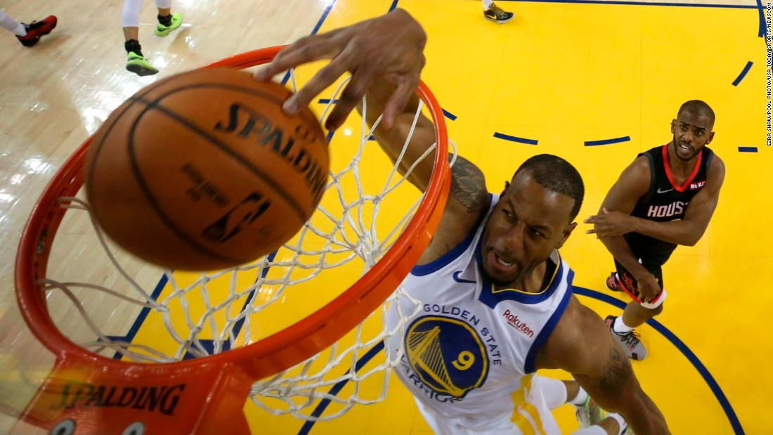 Golden State Warriors guard Andre Iguodala dunks the basketball against Houston Rockets guard Chris Paul during the first half of game five of the second round of the 2019 NBA Playoffs at Oracle Arena in Oakland, California.