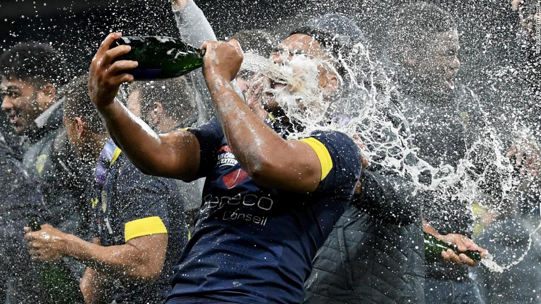 ASM Clermont player Fritz Lee celebrates with champagne after  the Challenge Cup Final match between La Rochelle and ASM Clermont at St. James Park on May 10, 2019, in Newcastle upon Tyne, United Kingdom.