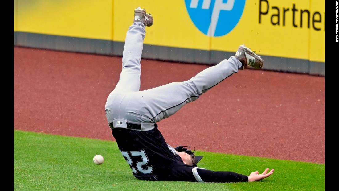 Chicago White Sox right fielder Charlie Tilson (22) loses his balance while reaching for a double by Cleveland Indians shortstop Francisco Lindor (not pictured) in the fifth inning at Progressive Field.