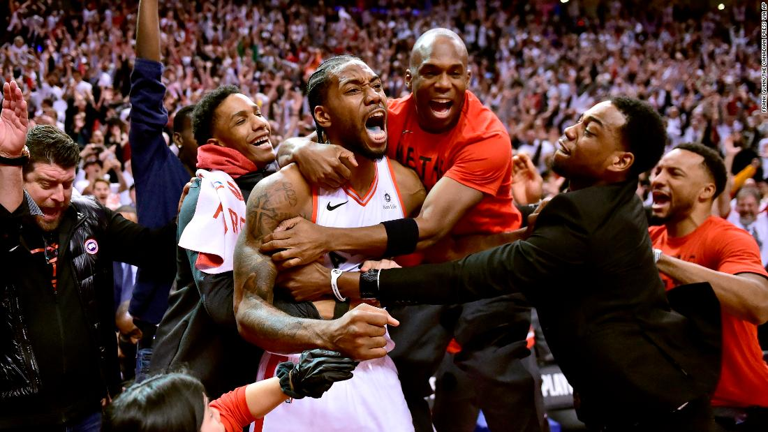 Toronto Raptors forward Kawhi Leonard, center, celebrates his game-winning basket as time expired at the end of an NBA Eastern Conference semifinal basketball game against the Philadelphia 76ers, in Toronto on Sunday, May 12. Toronto won 92-90.
