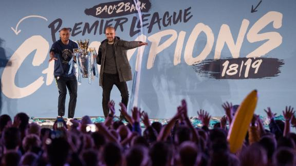 Manchester City's Spanish manager Pep Guardiola (R) and Manchester City's Belgian defender Vincent Kompany (L) show the Premier League trophy to supporters outside the Etihad Stadium in Manchester, northern England on May 12, 2019 - Manchester City held off a titanic challenge from Liverpool to become the first side in a decade to retain the Premier League on Sunday by coming from behind to beat Brighton 4-1 on Sunday. (Photo by OLI SCARFF / AFP)        (Photo credit should read OLI SCARFF/AFP/Getty Images)