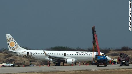 A general view shows a Myanmar National Airlines passenger plane after an emergency landing at Mandalay international airport on May 12, 2019.