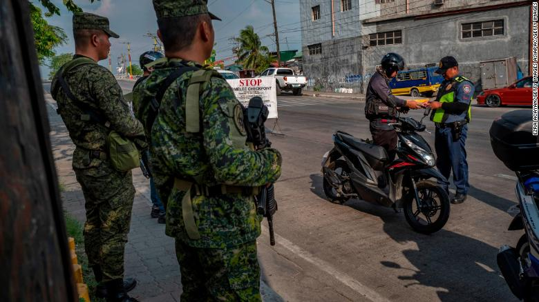 Military and police set up a checkpoint as part of security measures ahead of the midterm elections in Quezon city, Metro Manila.