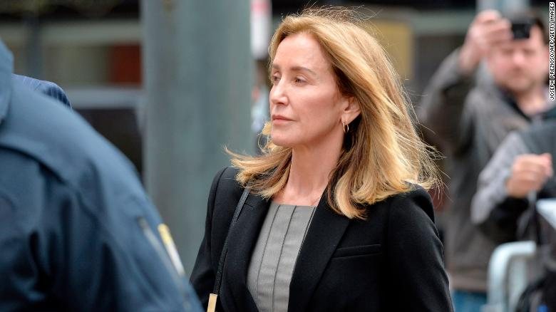 Image result for Actress Felicity Huffman cries as she pleads guilty in college admissions scandal
