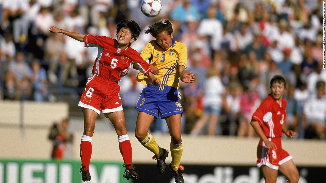 Lihong Zhao (6) of China and Sweden's Jane Tornqvist (3) battle for the ball in a tussle between the top two teams in Group D. China, the eventual finalists, would go on to win the match 2-1.