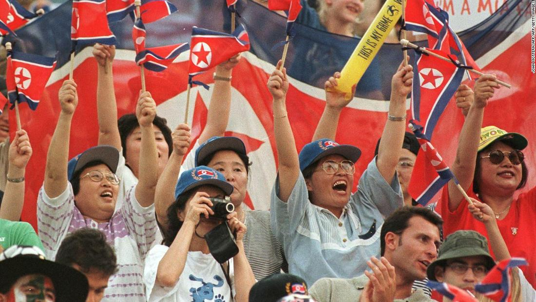 North Korea fans cheer before the team's match against the USA in Massachusetts. The visitors would fall to a 3-0 defeat and failed to qualify for the knockout stages.