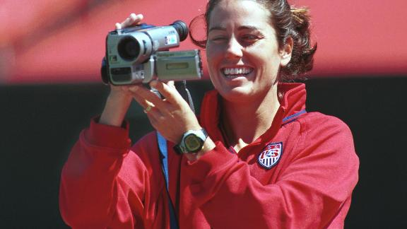 Foudy films her teammates at Stanford Stadium.