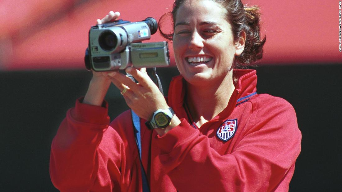 For younger readers, a camcorder is, according to the dictionary, a portable combined video camera and video recorder. USA co-captain Julie Foudy records her teammates at Stanford Stadium. Her footage would later feature in a documentary about the team.