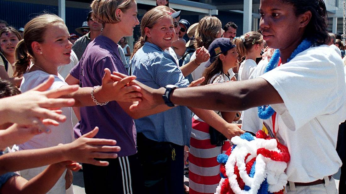 U.S. goalkeeper Briana Scurry thanks supporters who gathered at a fan rally on July 11 at the convention center in Los Angeles, California.