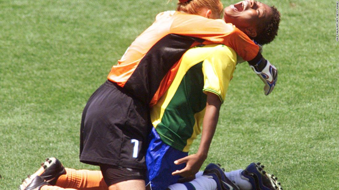 Brazil's Formiga (R) is hugged by goalie Maravihla after her game-winning shootout goal during the third-place playoff at the Rose Bowl as Brazil defeated Norway 5-4 on penalty kicks.