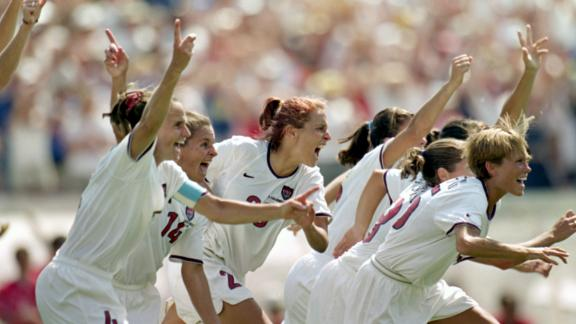 PASADENA, CA - JULY 10:  Joy Fawcett #14 Kate Sobrero #20 and Tisha  Venturini #15 of Team USA celebrate their victory in the Women's World Cup at The Rose Bowl on July 10, 1999 in Pasadena, California. (Photo by Elsa/Getty Images)