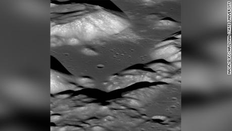 This is a view of the Taurus-Littrow valley taken by NASA's Lunar Reconnaissance Orbiter spacecraft. The valley was explored in 1972 by the Apollo 17 mission astronauts Eugene Cernan and Harrison Schmitt. They had to zig-zag their lunar rover up and over the cliff face of the Lee-Lincoln fault scarp that cuts across this valley. Credits: NASA/GSFC/Arizona State University