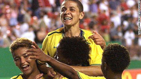 LANDOVER, UNITED STATES:  Brazil's Sissi (C) is swarmed by teammates 01 July 1999 after their quarter-final match with Nigeria in the Women's World Cup at Jack Kent Cooke Stadium in Landover, Maryland. Sissi scored the winning goal for Brazil in overtime to give them  a 4-3 win.     (ELECTRONIC IMAGE)   AFP PHOTO   Tim SLOAN (Photo credit should read TIM SLOAN/AFP/Getty Images)
