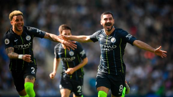 City's Ilkay Gundogan and Kyle Walker celebrate after the Turkish player scored City's fourth goal to seal the match against Brighton.