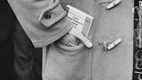 "A man carries a copy of D. H. Lawrence's book, ""Lady Chatterley's Lover"" soon after it was first published in full in the UK."