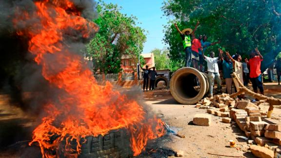 Sudanese protesters burn tires as they block Nile Street, a major thoroughfare, on Monday.
