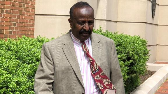 Yusuf Abdi Ali, an accused war criminal, leaves the federal courthouse in Alexandria, Virginia.