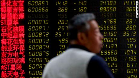 A man reacts as he monitors stock prices at a brokerage house in Beijing, Tuesday, May 14, 2019. Shares opened moderately lower in Asia on Tuesday after a dismal day on Wall Street as investors fled uncertainty over the China-U.S. trade standoff. (AP Photo/Andy Wong)