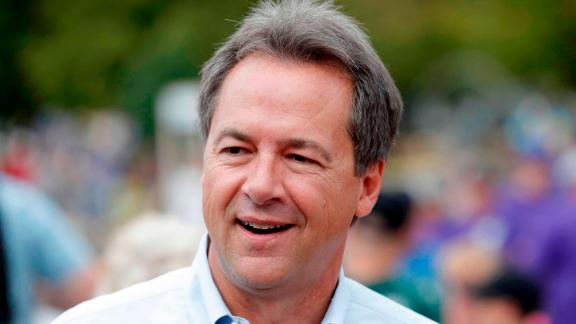 FILE - In this Aug. 16, 2018, file photo, Montana Gov. Steve Bullock walks down the main concourse during a visit to the Iowa State Fair in Des Moines, Iowa. Former Vice President Joe Biden and several nationally known senators are commanding most of the attention in Democrats