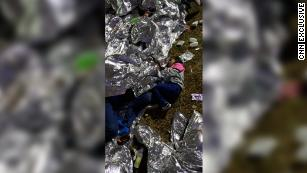 Exclusive photos reveal children sleeping on the ground at Border Patrol station