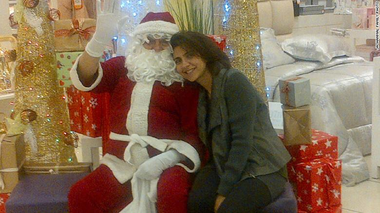 Shafali Jashanmal with her father, Mohan Jashanmal, who is dressed as Santa Claus to entertain the children who visit their store in a mall in Abu Dhabi.