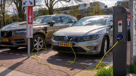 Volvo and VW electric cars recharge at a charging station in Amsterdam.