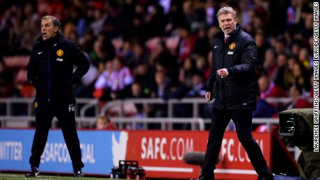 Moyes, then manager of Manchester United (R), with then assistant coach Phil Neville, who is now England Women's manager.