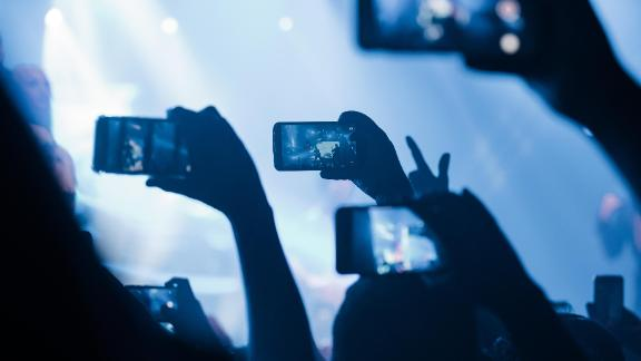 Audience members record and livestream on their smartphones at a concert in Sao Paulo, Brazil.