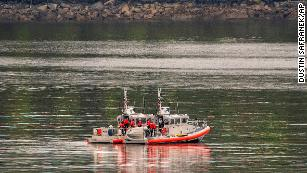 Two U.S. Coast Guard 45-foot response boats drift through George Inlet as part of a search effort on Tuesday near Ketchikan, Alaska.