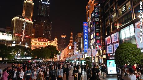 People walking through a shopping area in Shanghai. China's retail sales growth cooled significantly last month, according to figures released Wednesday.