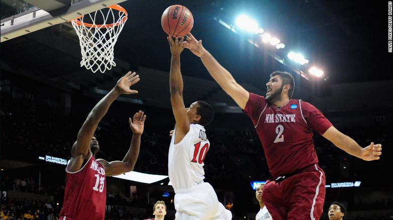 Sim Bhullar plays for the New Mexico State Aggies against the San Diego State Aztecs in the NCAA Men's Basketball Tournament on March 20, 2014 in Spokane, Washington.