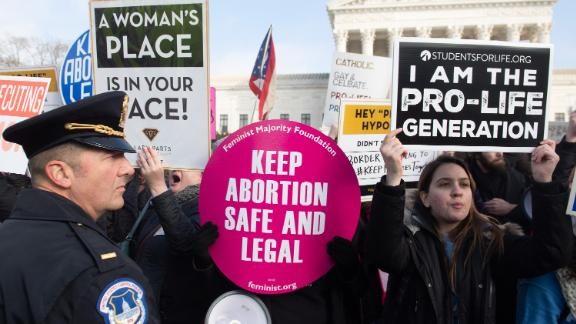 "Pro-choice activists hold signs in response to anti-abortion activists participating in the ""March for Life,"" an annual event to mark the anniversary of the 1973 Supreme Court case Roe v. Wade, which legalized abortion in the US, outside the US Supreme Court in Washington, DC, January 18, 2019. (Photo by SAUL LOEB / AFP)        (Photo credit should read SAUL LOEB/AFP/Getty Images)"