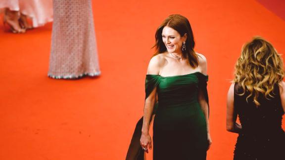 Julianne Moore wears emerald green Dior and matching Chopard earrings.
